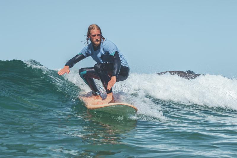 surf student surfing unbroken wave
