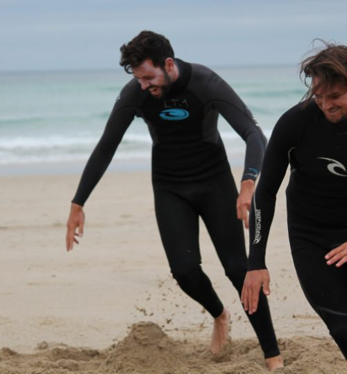 students warming up before surf