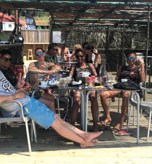 having a drink at a beach bar